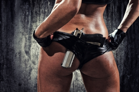 18525024 - sexy woman with hand gun